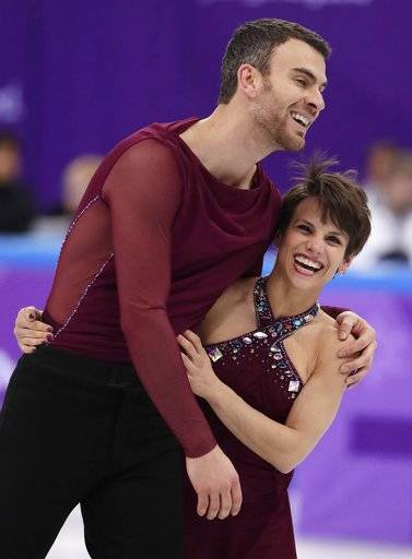 Meagan Duhamel and Eric Radford of Canada react after their performance in the team event pair skating in the Gangneung Ice Arena at the 2018 Winter Olympics in Gangneung, South Korea, Sunday, Feb. 11, 2018.
