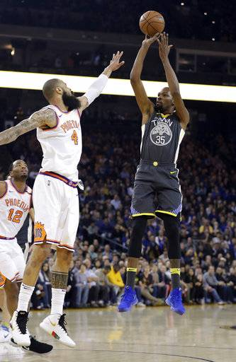 Golden State Warriors' Kevin Durant (35) shoots over Phoenix Suns' Tyson Chandler (4) during the first half of an NBA basketball game Monday, Feb. 12, 2018, in Oakland, Calif.