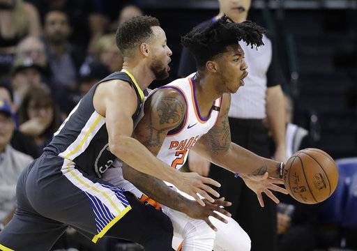 Phoenix Suns' Elfrid Payton, right, is defended by Golden State Warriors' Stephen Curry during the first half of an NBA basketball game Monday, Feb. 12, 2018, in Oakland, Calif.