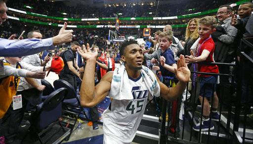 Utah Jazz guard Donovan Mitchell (45) celebrates as he runs off the court following their NBA basketball game against the San Antonio Spurs Monday, Feb. 12, 2018, in Salt Lake City. The Jazz won 101-99.