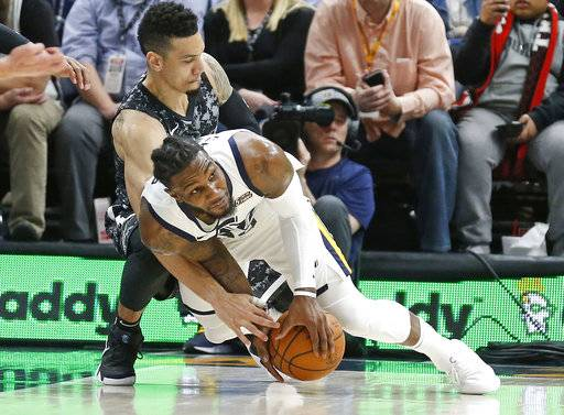 Utah Jazz forward Jae Crowder, foreground, and San Antonio Spurs guard Danny Green battle for a loose ball in the second half of an NBA basketball game Monday, Feb. 12, 2018, in Salt Lake City. The Jazz won 101-99.