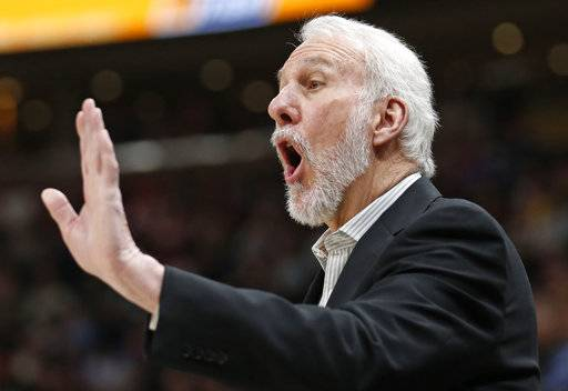 San Antonio Spurs head coach Gregg Popovich shouts to his team in the first half of an NBA basketball game against the Utah Jazz Monday, Feb. 12, 2018, in Salt Lake City.
