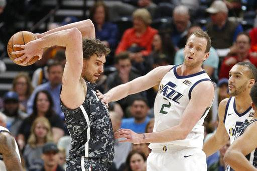 San Antonio Spurs center Pau Gasol, left, passes the ball as Utah Jazz's Joe Ingles (2) and Rudy Gobert, right, look on in the first half during an NBA basketball game Monday, Feb. 12, 2018, in Salt Lake City.