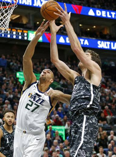 Utah Jazz center Rudy Gobert (27) and San Antonio Spurs center Pau Gasol, right, reach for a rebound in the first half during an NBA basketball game Monday, Feb. 12, 2018, in Salt Lake City.