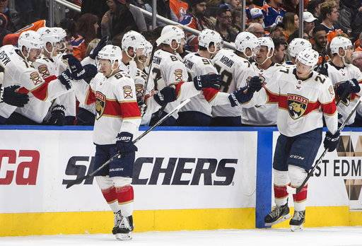 Florida Panthers right wing Evgenii Dadonov (63) and centre Nick Bjugstad (27) celebrate a goal against the Edmonton Oilers during second period NHL action in Edmonton, Alberta, Monday Feb. 12, 2018. (Jason Franson/The Canadian Press via AP)