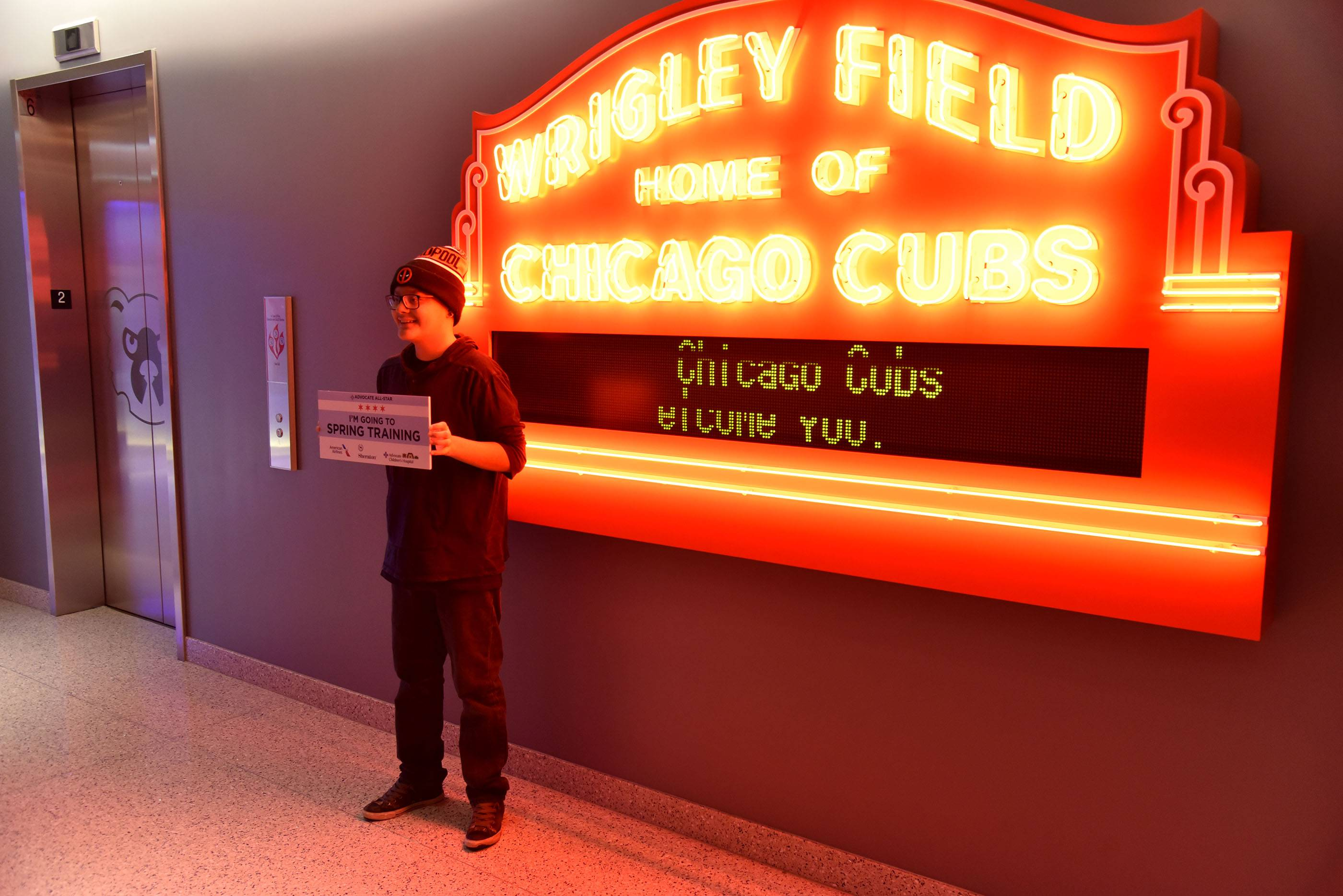 Jonathan Olmos, 16, of Des Plaines poses for a photo Wednesday at Wrigley Field where he learned he was among four patients at Advocate Children's Hospital in Park Ridge who received a free trip to see the Chicago Cubs in spring training in Arizona.