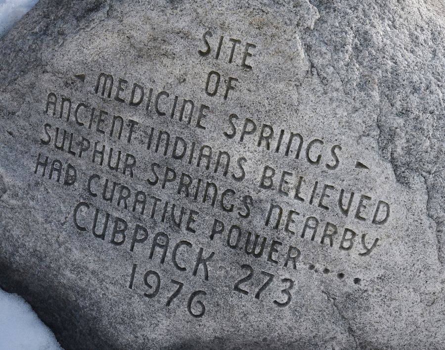 An inscription is written on a boulder on the west side of the Rockland Road bridge in Libertyville. The rock will be protected when the decorative steel truss is removed.