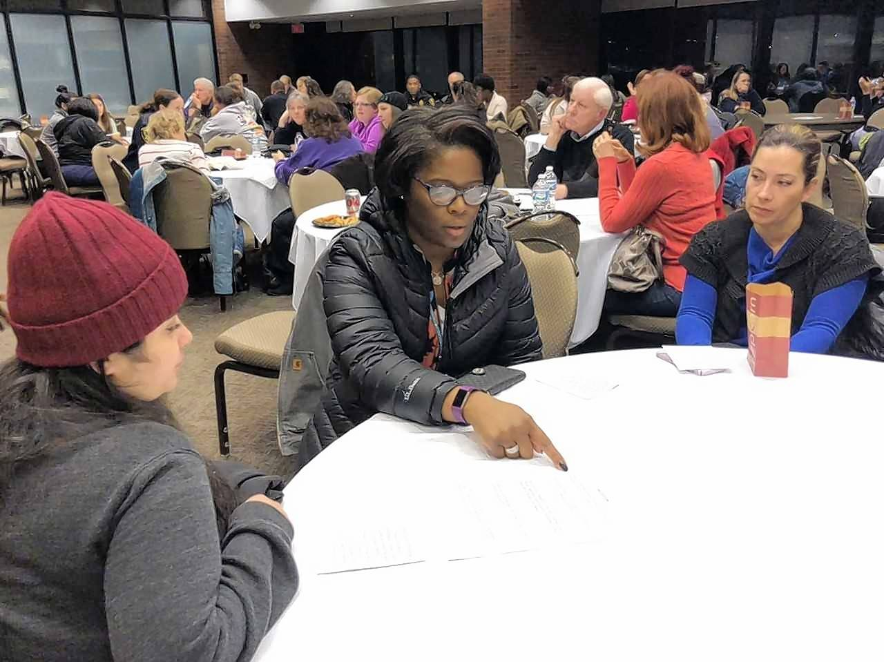 Elgin Community College student Michelle Cortez of St. Charles, left, Charlotte Coleman of South Elgin, and ECC student Claudia Ramirez of Carol Stream discuss how racism affects their lives Tuesday after watching a documentary about the criminalization and mass incarceration of blacks.