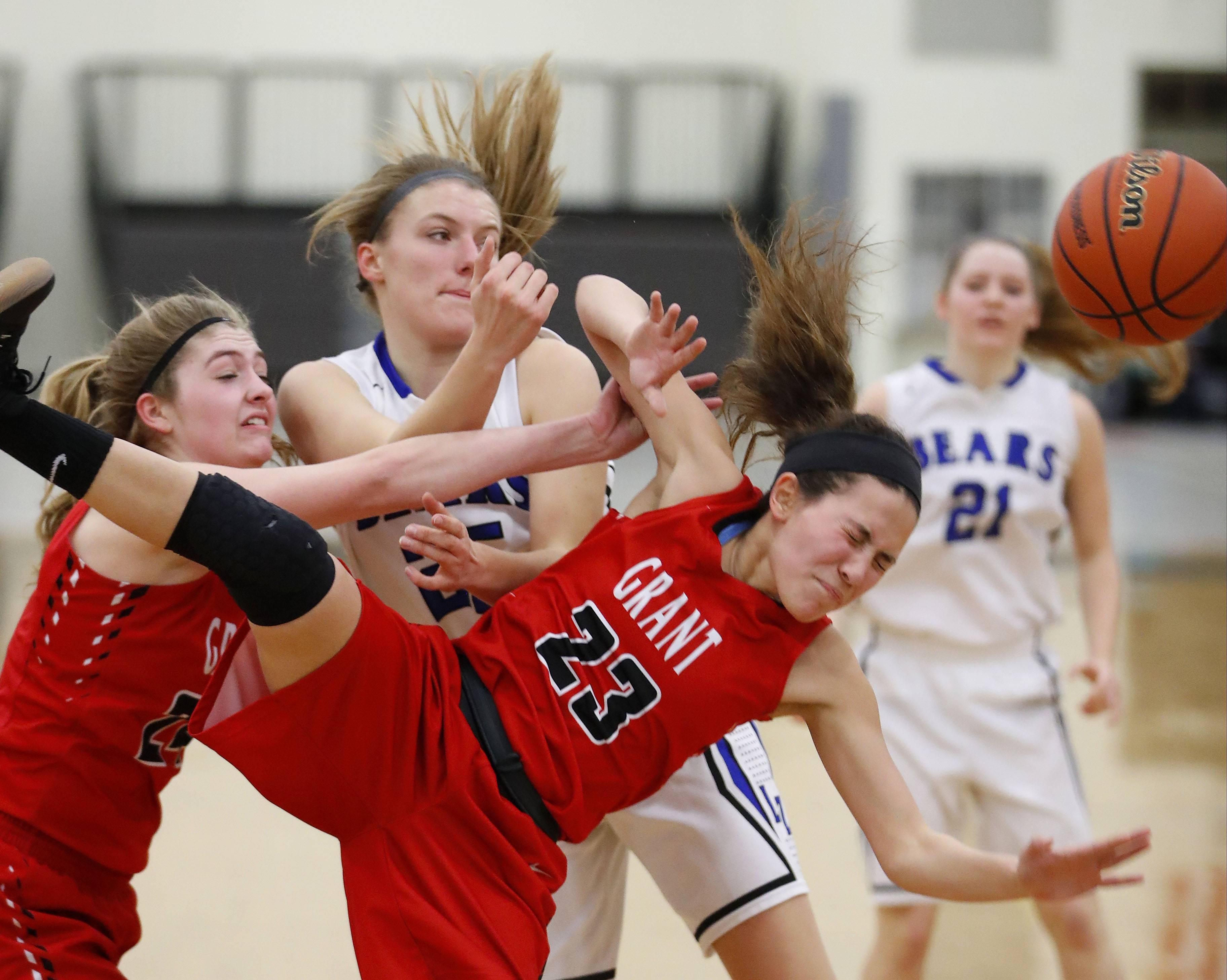 Grant's Mercedes Uribe (23) is fouled by Lake Zurich's Maddy Piggott.