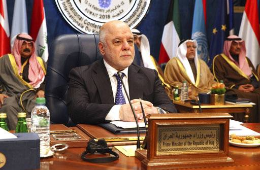 Iraqi Prime Minister Haider al-Abadi prepares for a donor's summit at Bayan Palace in Kuwait City, Kuwait, Wednesday, Feb. 14, 2018. Kuwait on Wednesday hosted the final day of a conference seeking billions of dollars to help rebuild Iraq after the war against the Islamic State group.