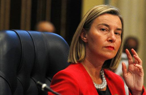 European Union foreign policy chief Federica Mogherini prepares for a donor's summit at Bayan Palace in Kuwait City, Kuwait, Wednesday, Feb. 14, 2018. Kuwait on Wednesday hosted the final day of a conference seeking billions of dollars to help rebuild Iraq after the war against the Islamic State group.