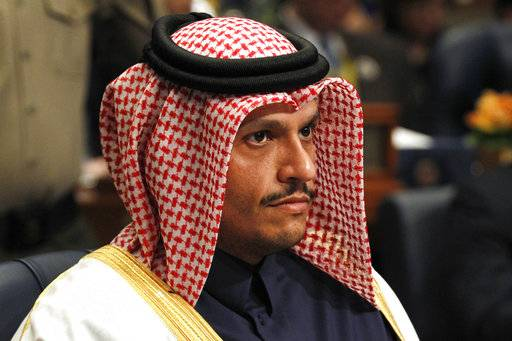 Qatar's Foreign Minister Sheikh Mohammed bin Abdulrahman Al Thani prepares for a donor's summit at Bayan Palace in Kuwait City, Kuwait, Wednesday, Feb. 14, 2018. Kuwait on Wednesday hosted the final day of a conference seeking billions of dollars to help rebuild Iraq after the war against the Islamic State group.