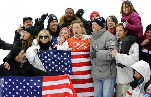 Shaun White, of the United States, celebrates winning gold after the men's halfpipe finals at Phoenix Snow Park at the 2018 Winter Olympics in Pyeongchang, South Korea, Wednesday, Feb. 14, 2018.