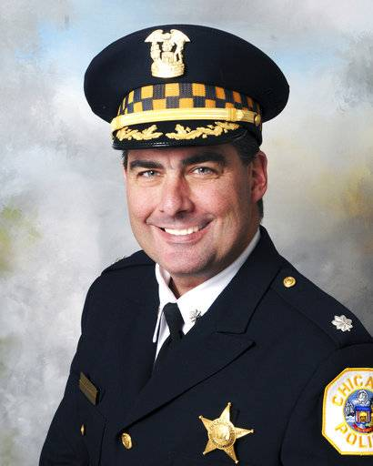 This Oct. 19, 2016 photo provided by the Chicago Police Department shows Chicago Police Commander Paul Bauer. Cmdr. Bauer was killed after a foot chase Tuesday, Feb. 13, 2018 in downtown Chicago. He was shot in the head by a suspect carrying a semi-automatic handgun equipped with an extended clip of ammunition, a police official told The Associated Press on Wednesday. Bauer had been on the police force for 31 years. (Chicago Police Department via AP)