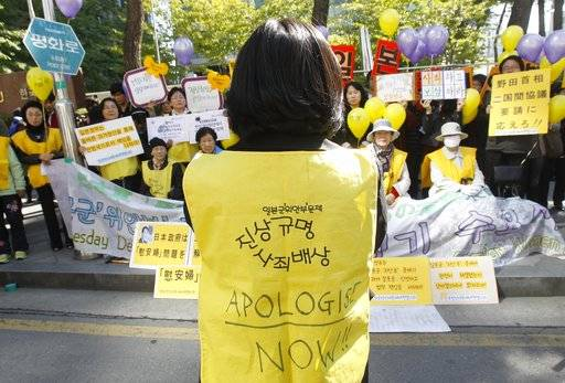 FILE - In this Oct. 19, 2011 file photo, former South Korean comfort women who were forced to serve for the Japanese Army as sexual slaves during World War II, stage a rally to demand an official apology and compensation from the Japanese government in front of the Japanese Embassy in Seoul, South Korea. The fierce grudges over historical persecution and a thousand perceived national and cultural slights cannot be untwined from the sports for many Koreans, and these swirling emotions will be front and center Wednesday, Feb. 14, 2018, when a combined team of North and South Koreans plays regional power Japan in women's hockey.