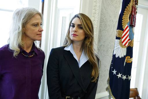 White House Communications Director Hope Hicks, right, stands with White House senior adviser Kellyanne Conway during a meeting in the Oval Office between President Donald Trump and Shane Bouvet, Friday, Feb. 9, 2018, in Washington.