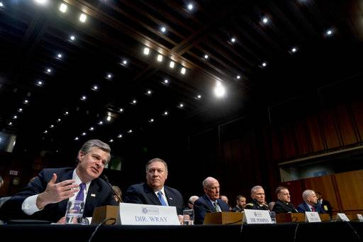 From left, FBI Director Christopher Wray, accompanied by CIA Director Mike Pompeo, Director of National Intelligence Dan Coats, Defense Intelligence Agency Director Robert Ashley, National Security Agency Director Adm. Michael Rogers, and National Geospatial-Intelligence Agency Director Robert Cardillo, speaks at a Senate Select Committee on Intelligence hearing on worldwide threats, Tuesday, Feb. 13, 2018, in Washington.