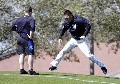 New York Yankees starting pitcher Masahiro Tanaka, of Japan, right, does drills at baseball spring training camp, Wednesday, Feb. 14, 2018, in Tampa, Fla.