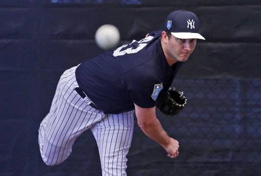 New York Yankees relief pitcher Adam Warren throws in the bullpen at baseball spring training camp, Wednesday, Feb. 14, 2018, in Tampa, Fla.