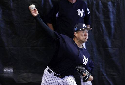 New York Yankees starting pitcher Masahiro Tanaka, of Japan, throws in the bullpen at baseball spring training camp, Wednesday, Feb. 14, 2018, in Tampa, Fla.
