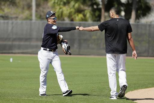 New York Yankees starting pitcher Masahiro Tanaka, of Japan, left, bumps fists with relief pitcher Dellin Betances at baseball spring training camp, Wednesday, Feb. 14, 2018, in Tampa, Fla.