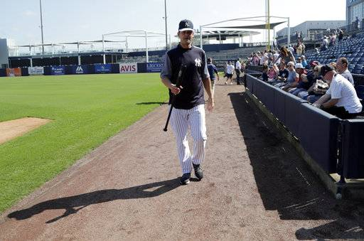 New York Yankees manager Aaron Boone walks on the field at baseball spring training camp, Wednesday, Feb. 14, 2018, in Tampa, Fla.