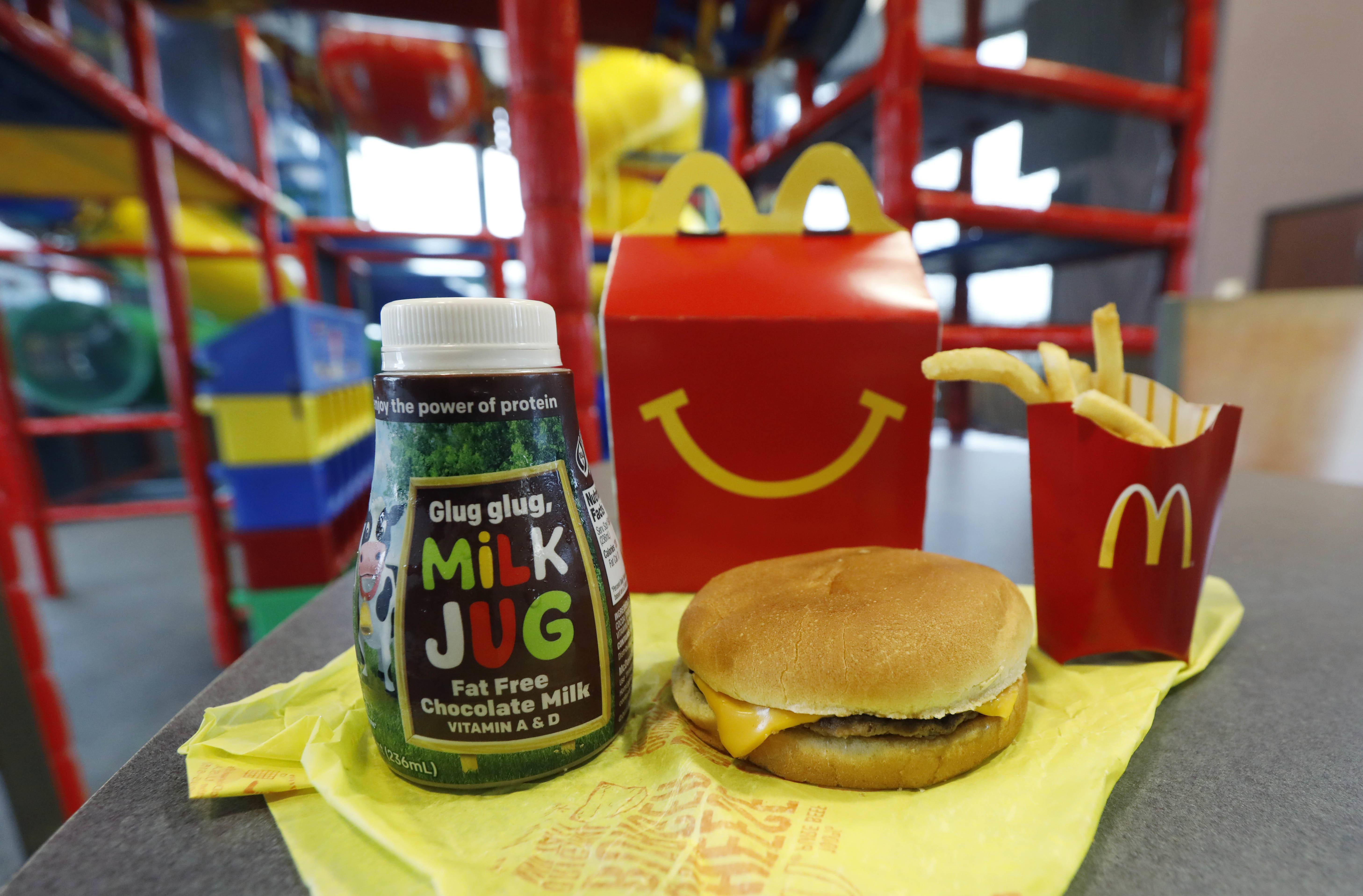 McDonald's will soon banish cheeseburgers and chocolate milk from its Happy Meal menu in an effort to cut down on the calories, sodium, saturated fat and sugar that kids consume at its restaurants. Diners can still ask specifically for cheeseburgers or chocolate milk with the kid's meal, but the fast-food company said that not listing them will reduce how often they're ordered.