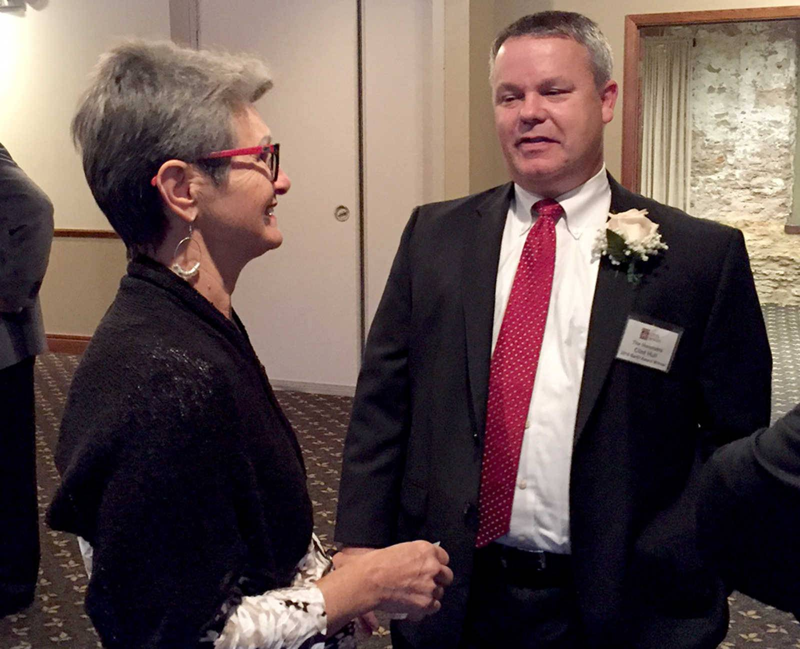 The 2016 Barth Award winner, the Honorable Clint Hull, chats with former winner Cris Anderson at the awards banquet. Hull recently won the Charlemagne Award as well for his service to the community.