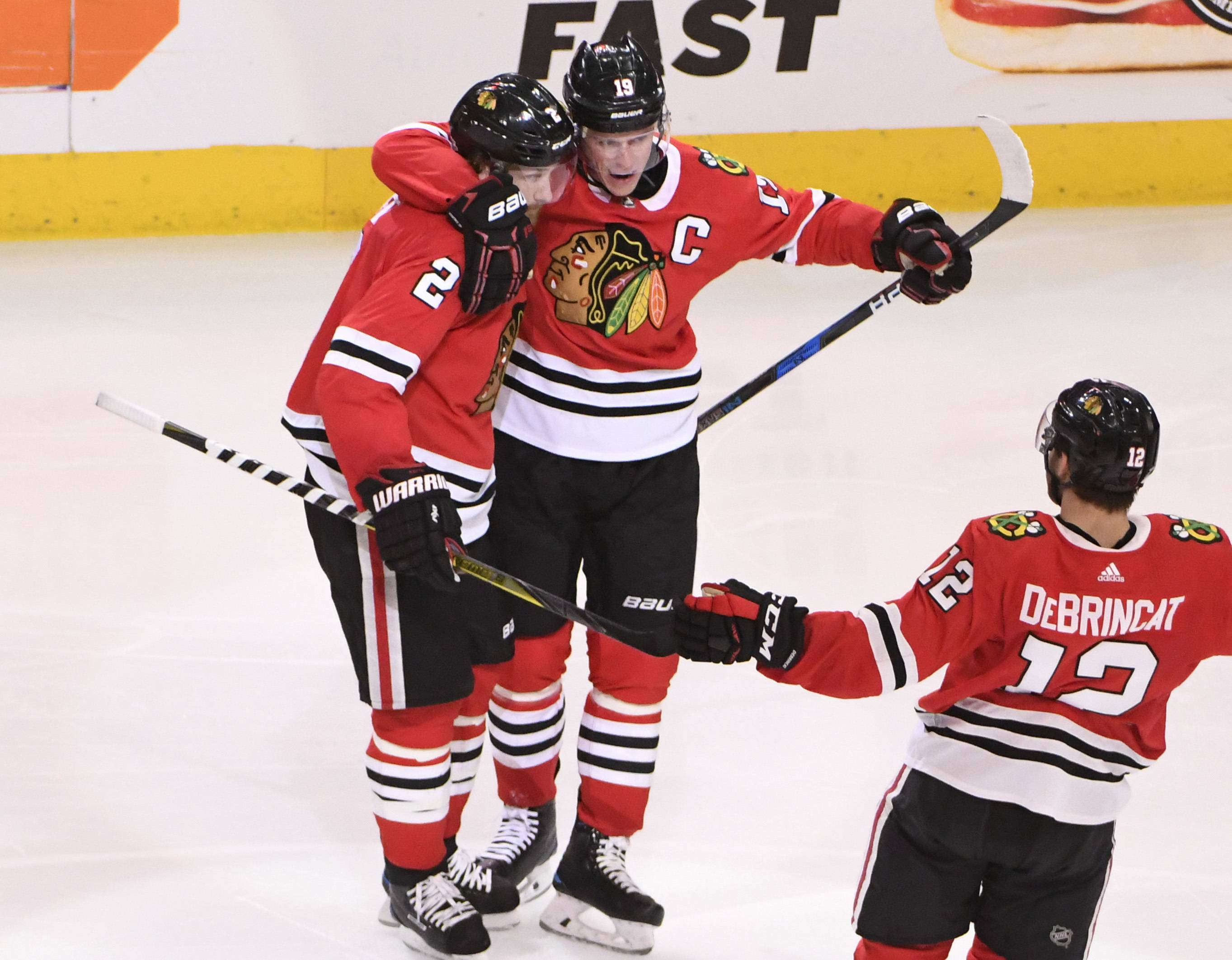 Chicago Blackhawks defenseman Duncan Keith (2) celebrates his goal against the Anaheim Ducks with center Jonathan Toews (19) and right wing Alex DeBrincat (12) during the second period of an NHL hockey game Thursday, Feb. 15, 2018, in Chicago. (AP Photo/David Banks)