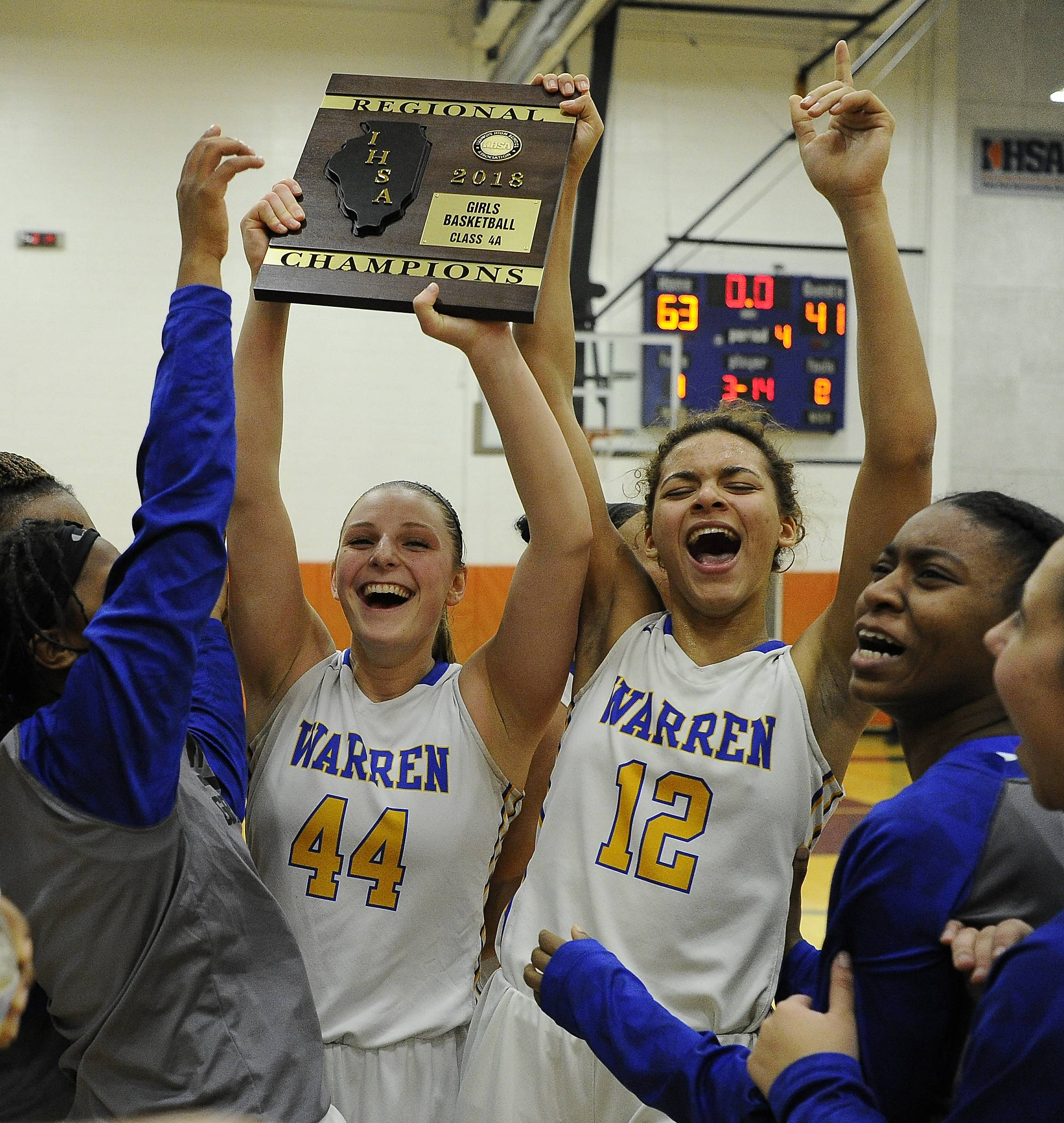 Kaylen Dickson, right, and teammate Jordyn Hughes celebrate a Warren win.