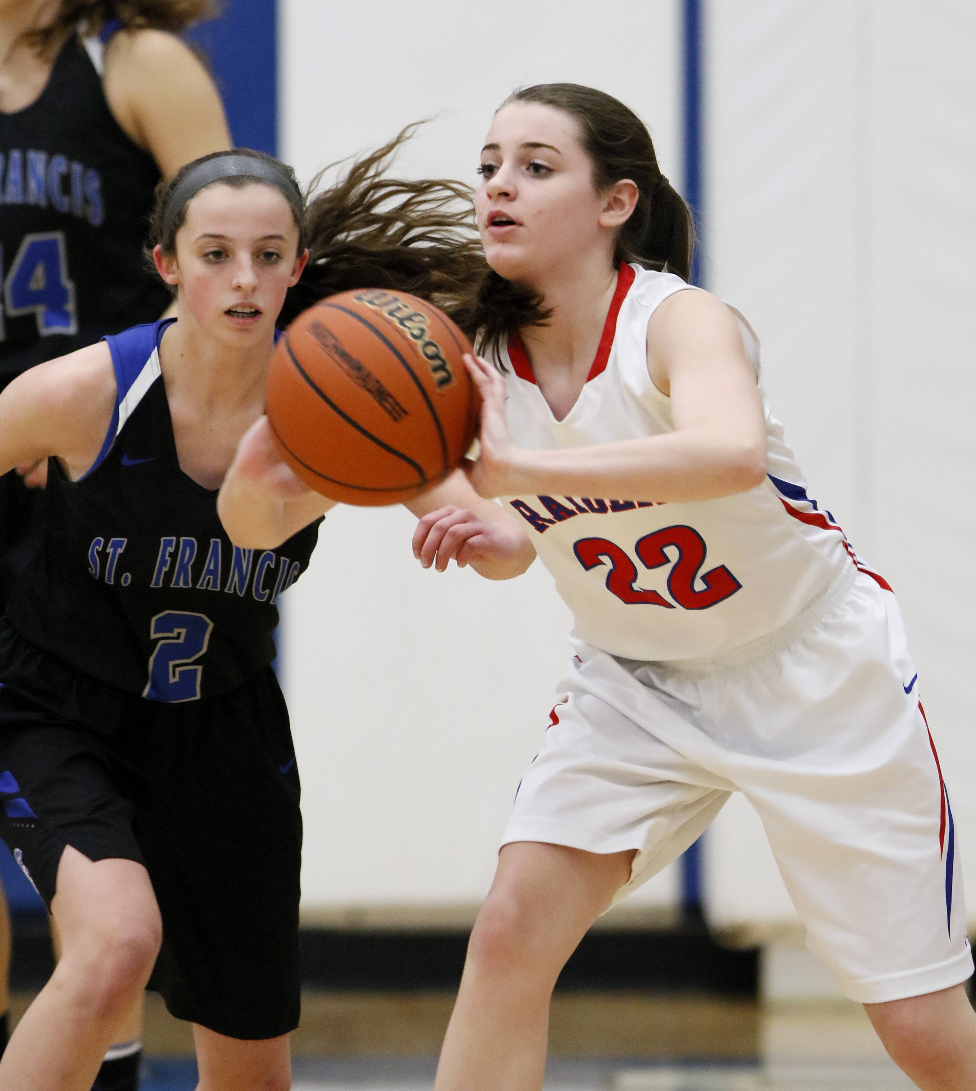 Glenbard South's Raquel LaPonte (22) passes the ball around St. Francis' Shannon Cooney (2).