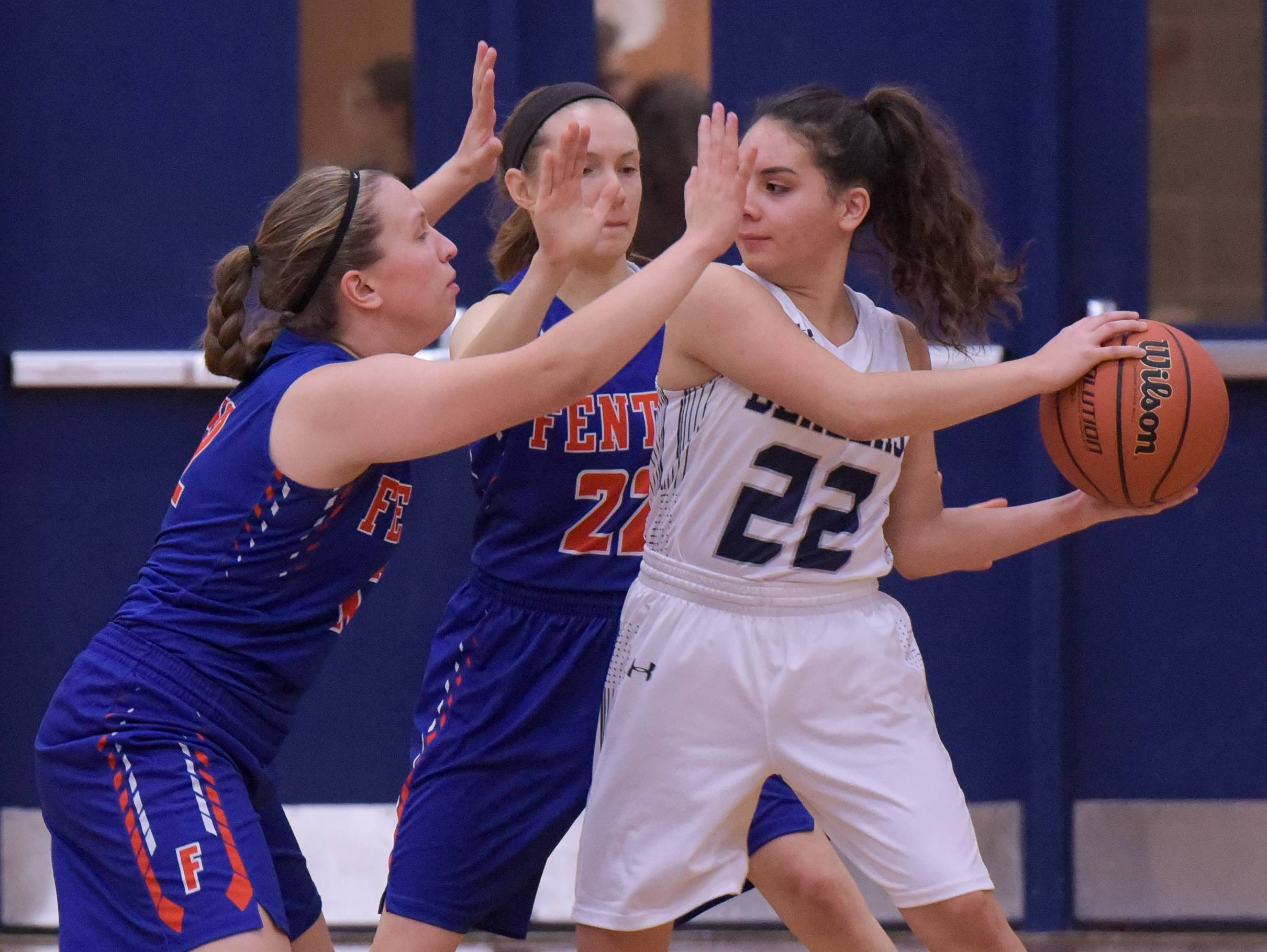 Addison Trail's Angelina Carreras (22) is double teamed by Fenton's Jamie Minard (12) and Julia Kaspari (22) during varsity girls basketball on November 21, 2017.