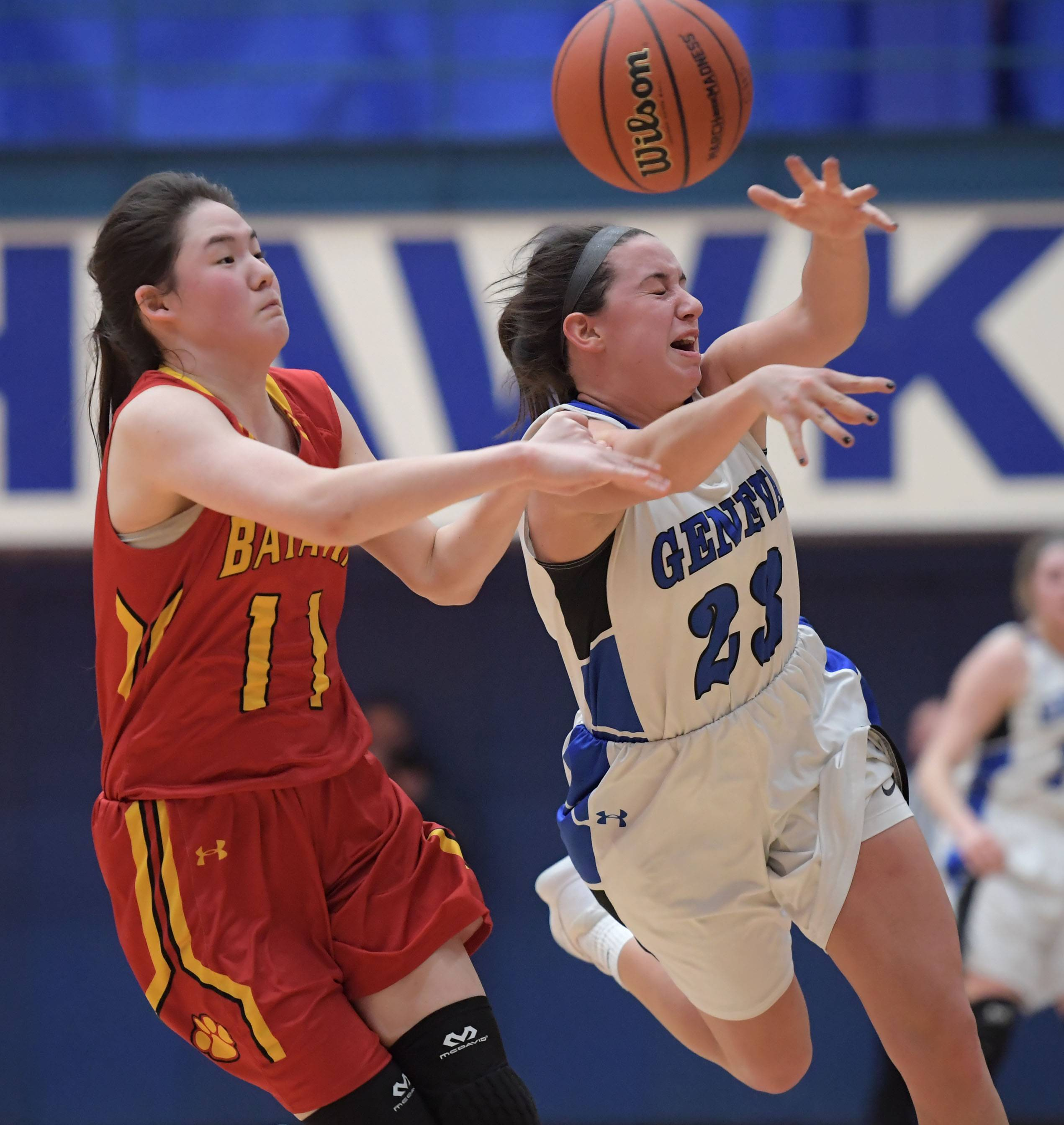 John Starks/jstarks Geneva's Margaret Whitley deflects a pass to Batavia's Jenna Laughlin in the regional championship girls basketball game in Hoffman Estates.