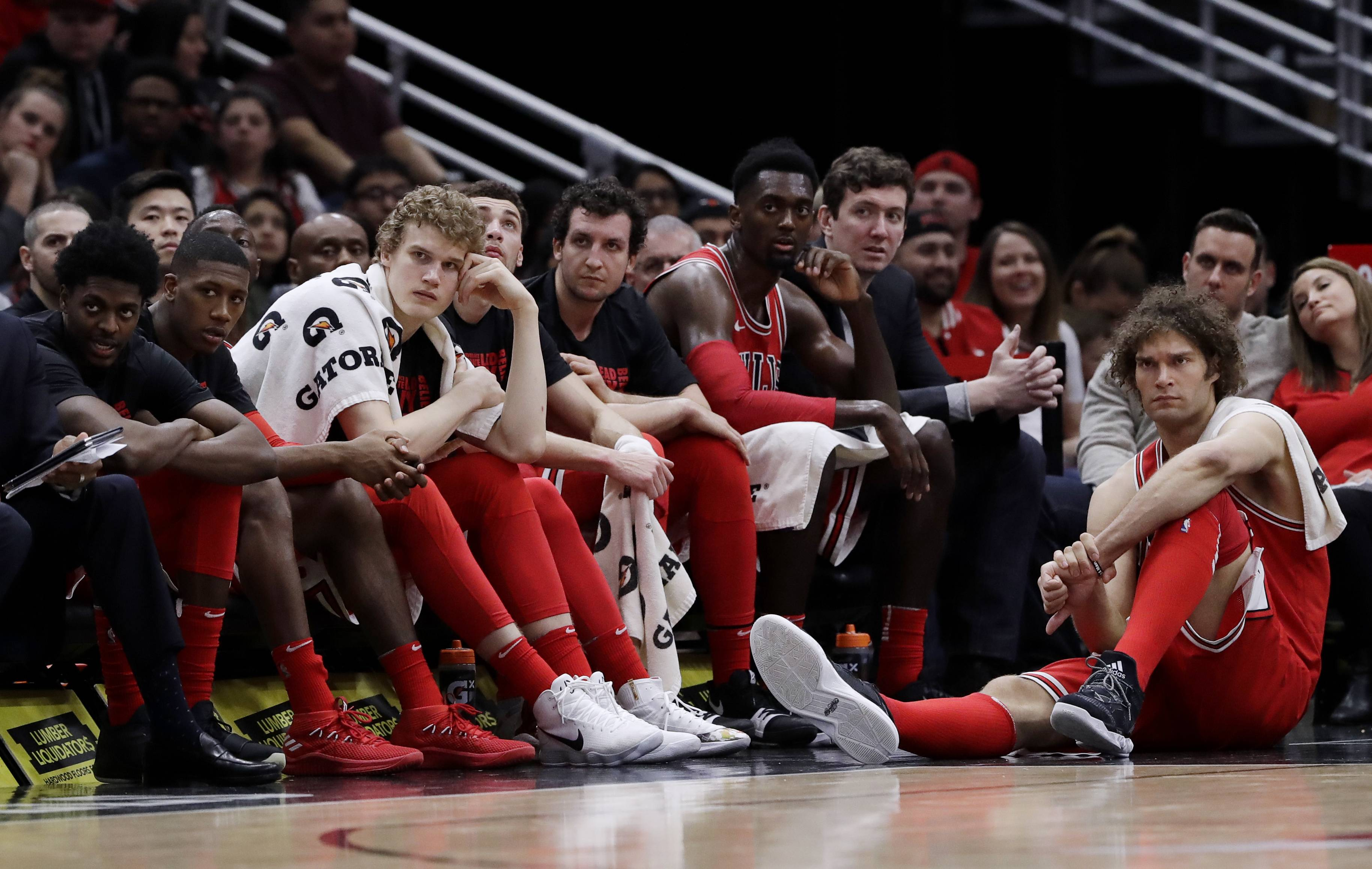 Chicago Bulls players react as they watch teammates during the second half of an NBA basketball game against the Toronto Raptors, Wednesday, Feb. 14, 2018, in Chicago. The Raptors won 122-98.