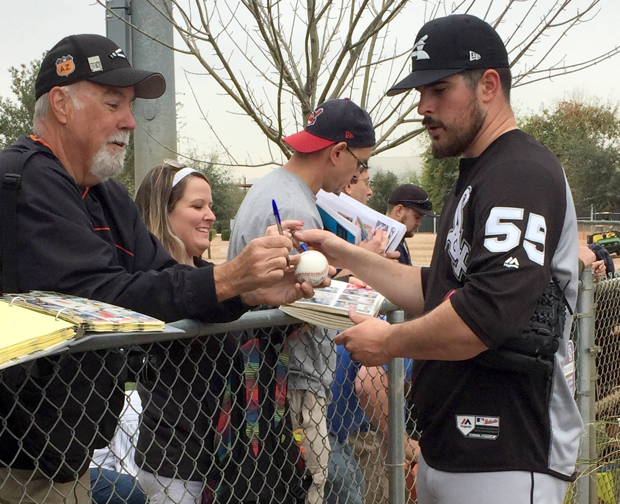 The Chicago White Sox work out at spring training at Glendale, Arizona, and Camelback Ranch on Thursday, Feb. 15, 2018. Carlos Rodon signs autographs.