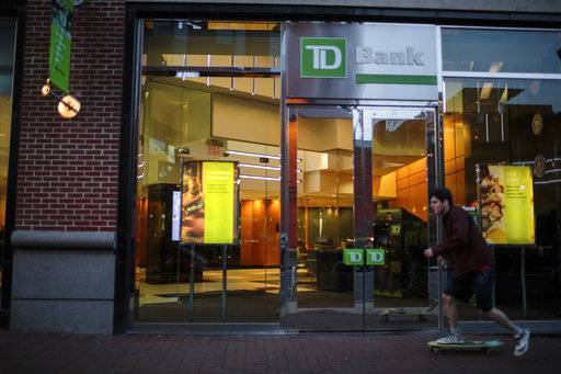 ADVANCE FOR USE THURSDAY, FEB. 15, 2018, AT 12:01 A.M. AND THEREAFTER - This Nov. 12, 2017, photo provided by Reveal shows a TD Bank storefront in Philadelphia. African American and Latino borrowers are more likely to get turned down by TD Bank than by any other major mortgage lender. The bank turned down 54 percent of black homebuyers and 45 percent of Latino homebuyers, more than three times the industry averages. (Sarah Blesener/Reveal via AP)
