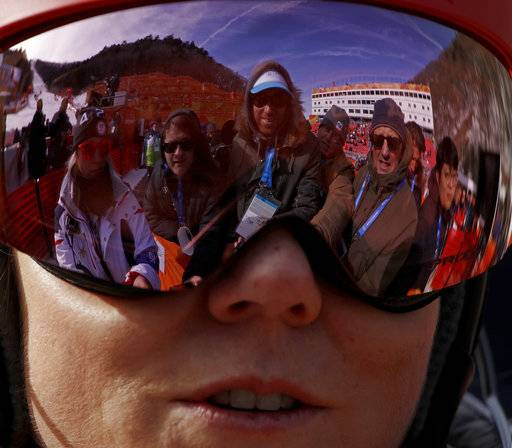 Mikaela Shiffrin, of the United States, talks to the media after her first run of the women's slalom at the 2018 Winter Olympics in Pyeongchang, South Korea, Friday, Feb. 16, 2018. (AP Photo/Charlie Riedel)