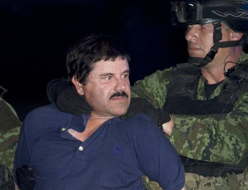 "FILE - In this Jan. 8, 2016, file photo, Mexican drug lord Joaquin ""El Chapo"" Guzman is made to face the press as he is escorted to a helicopter in handcuffs by Mexican soldiers and marines at a federal hangar in Mexico City, Mexico. Notorious Mexican drug lord and escape artist Joaquin ""El Chapo"" Guzman is eager to go to trial, his lawyer said Thursday, Feb. 15, 2018 after a U.S. judge set Sept. 5 for jury selection in his drug-trafficking case. (AP Photo/Marco Ugarte, File)"
