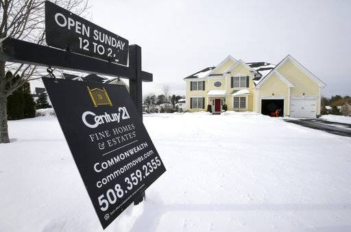 FILE- This Jan. 8, 2018, file, photo shows an existing home for sale in Walpole, Mass. On Thursday, Feb. 15, 2018, Freddie Mac reports on the week's average U.S. mortgage rates. (AP Photo/Steven Senne, File)
