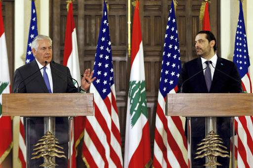 U.S. Secretary of State Rex Tillerson, left, speaks during a press conference with Lebanese Prime Minister Saad Hariri, at the Government House, in downtown Beirut, Lebanon, Thursday, Feb. 15, 2018. Tillerson is urging Hezbollah to cease its activities abroad to help reduce tensions in the region. (AP Photo/Bilal Hussein)