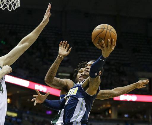 Denver Nuggets' Gary Harris shoots as Milwaukee Bucks' Sterling Brown, rear, defends during the first half of an NBA basketball game Thursday, Feb. 15, 2018, in Milwaukee. (AP Photo/Tom Lynn)