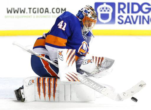 New York Islanders goaltender Jaroslav Halak (41), of Slovakia, makes a save during the third period of an NHL hockey game against the New York Rangers in New York, Thursday, Feb. 15, 2018. (AP Photo/Kathy Willens)