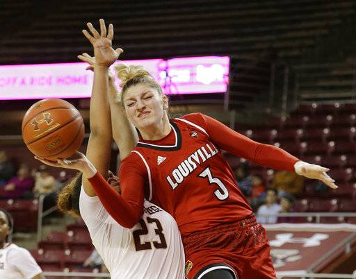 Louisville forward Sam Fuehring (3) takes the ball to the hoop past the defense of Boston College guard Milan Bolden-Morris (23) during the first half of their NCAA college basketball game Thursday, Feb. 15, 2018, in Boston. (AP Photo/Stephan Savoia)