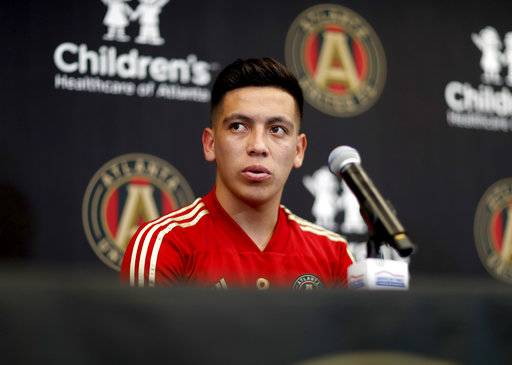 Ezequiel Barco, of Argentina, speaks during a news conference introducing him to the Atlanta United MLS soccer team in Marietta, Ga., Thursday, Feb. 15, 2018. Atlanta United has high expectations for a new, young star in its second season after paying an MLS-record transfer fee of $15 million for 18-year-old Barco. Barco joins Atlanta's wave of young stars from South America that also includes Miguel Almiron, Hector Villalba and Josef Martinez. (AP Photo/David Goldman)