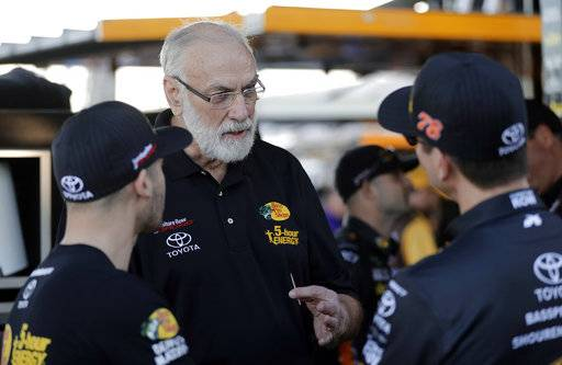 Barney Visser, center, team owner of Furniture Row Racing, talks with crew members before the first of two qualifying races for the NASCAR Daytona 500 auto race at Daytona International Speedway in Daytona Beach, Fla., Thursday, Feb. 15, 2018. Visser suffered a heart attack and missed the last two races of the season and Martin Truex Jr. winning the championship. (AP Photo/Chuck Burton)