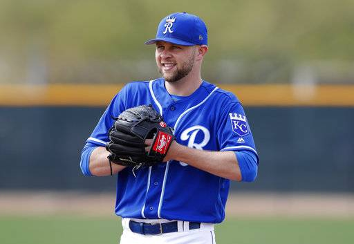 Kansas City Royals pitcher Jesse Hahn participates in a drill during a baseball spring training workout, Thursday, Feb. 15, 2018, in Surprise, Ariz. (AP Photo/Charlie Neibergall)