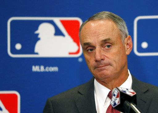"FILE - In this Aug. 17, 2017, file photo, Commissioner Rob Manfred listens to a question following the two-day meeting of Major League Baseball owners in Chicago. Baseball Commissioner Rob Manfred says proposed rules changes to speed pace of play with be in place by the start of big league exhibition games on Feb. 23, 2018. Speaking Thursday, Feb. 15, 2018 at Tropicana Field, Manfred says ""one way or the other'' there will be rule changes. (AP Photo/Charles Rex Arbogast, File)"
