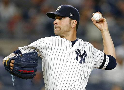 FILE - In this Monday, Sept. 18, 2017 file photo, New York Yankees starting pitcher Jaime Garcia delivers during the second inning of a baseball game against the Minnesota Twins in New York. Left-hander Jaime Garcia and the Toronto Blue Jays have agreed to a $10 million, one-year contract that includes a 2019 team option. Garcia gets $8 million this year as part of the deal announced Thursday, Feb. 15, 2018. (AP Photo/Kathy Willens, File)