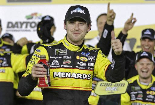 Ryan Blaney celebrates in Victory Lane after winning the first of two qualifying races for the NASCAR Daytona 500 auto race at Daytona International Speedway in Daytona Beach, Fla., Thursday, Feb. 15, 2018. (AP Photo/Chuck Burton)