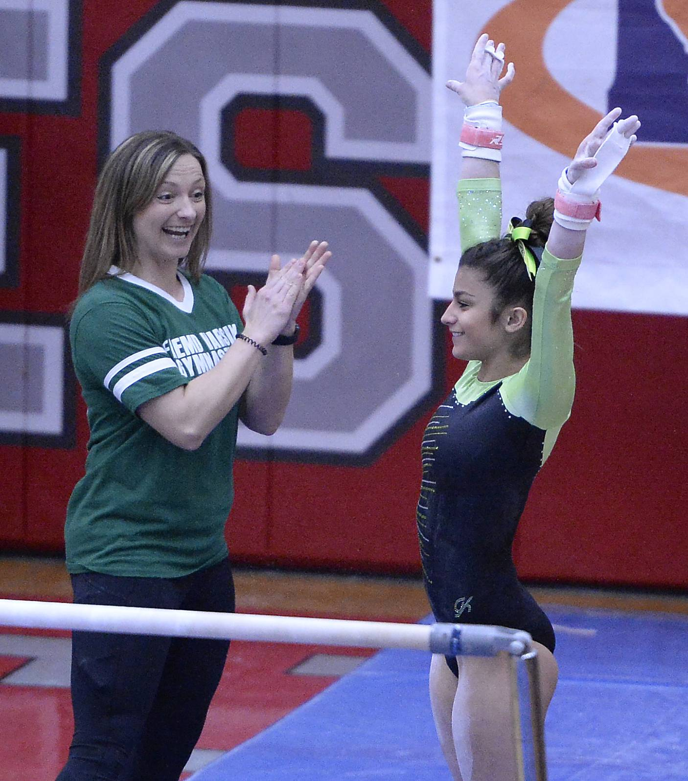 Gianna Christodoulopoulos performs on the uneven parallel bars.